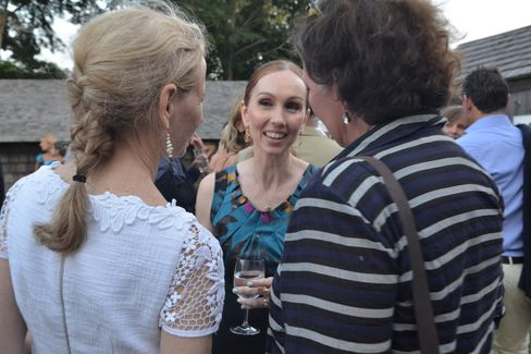 Andrea Grover, center, chats with Guild Hall gala guests.