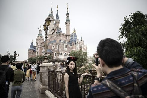 A visitor poses by the Enchanted Storybook Castle.