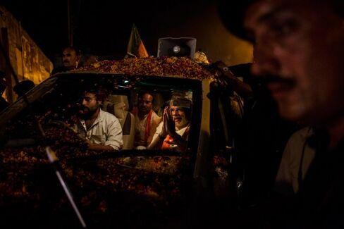 Indian Investors Celebrate After Polls Show a Big Win for Modi