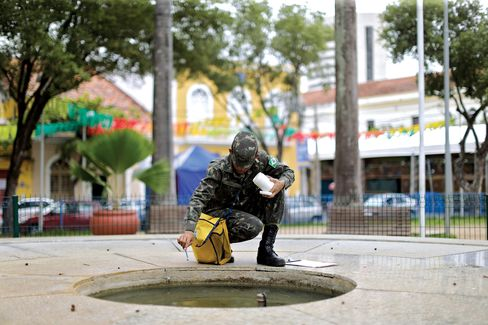 A Brazilian soldier conducts a street inspection in Recife.
