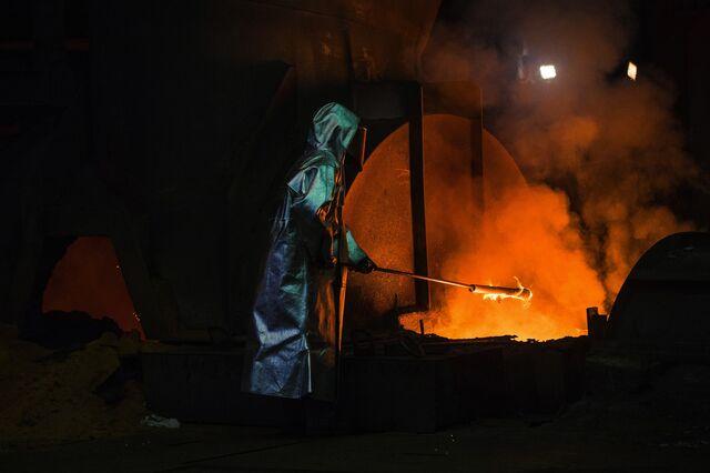 Worker in a blast furnace