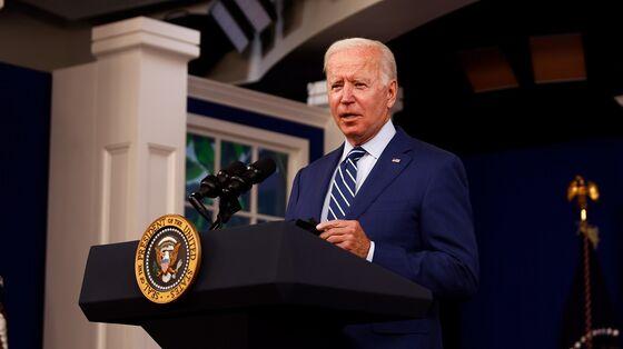 Biden Signs Government Funding Bill to Avert a Shutdown