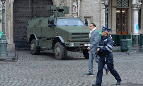 Belgian security forces patrol on the streets
