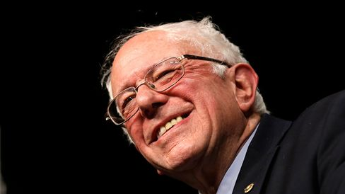 Democratic presidential candidate Bernie Sanders smiles during a campaign rally on March 8, 2016, in Miami.