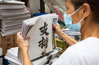 Readers Buy Copies of the Apple Daily on Its 26th Anniversary
