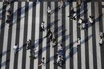 Pedestrians cross an intersection in Tokyo, Japan.