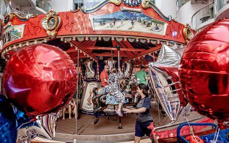 Guests enjoy the carousel in the amusement park-style Boardwalk neighborhood.