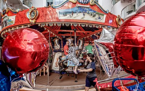 Guests enjoy the carousel in the amusement park-style Boardwalk neighborhood.