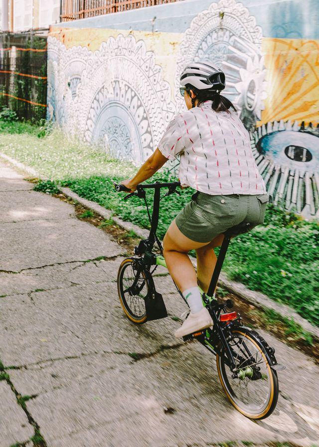 Karen Yung commutes on a custom two-speed Brompton folding bicycle.