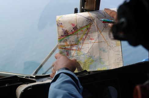Search and rescue crew scour Vietnamese waters looking for the missing Malaysia Airlines MH370.