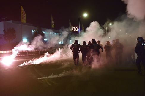 Right-wing demonstrators clash with police as they protest against a refugees camp in Heidenau, Germany.