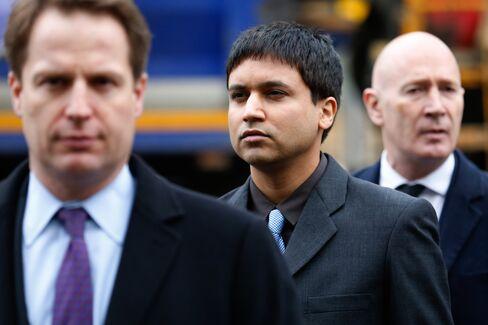 Navinder Singh Sarao, center, arrives at Westminster Magistrates' Court.