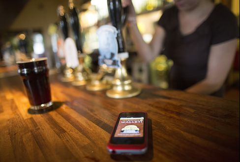 A Bitcoin App is Displayed on a Smartphone in a Bar