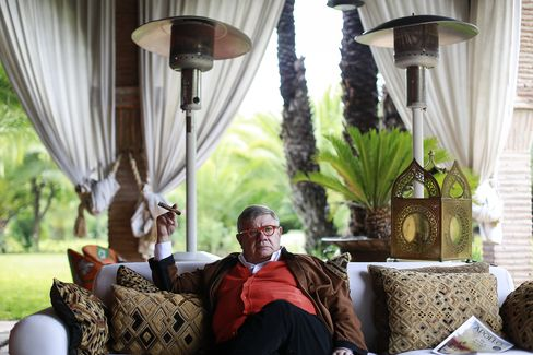 Jean-Yves Ollivier pauses while smoking a cigar during an interview at his Marrakesh house.