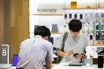 Customers try out the Samsung Electronics Co. Galaxy Note 8 smartphone at the company's D'light flagship store in Seoul, South Korea.