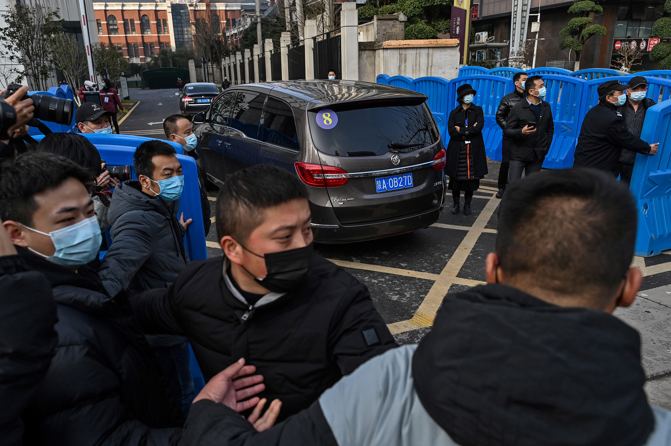 Members of the World Health Organizationteam investigating the origins of the Covid-19 coronavirus arrive at the Wuhan centre for disease control and prevention in Wuhanon Feb. 1.