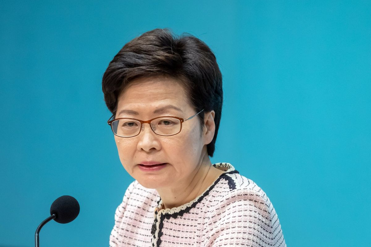 Hong Kong Leader Jokes About Need for Law to Muzzle Media Leaks