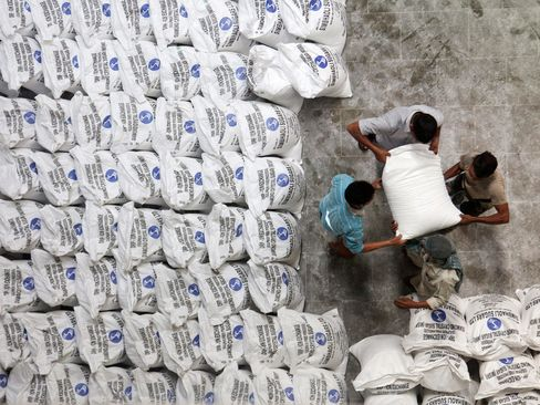 Workers pack bags of sugar at a plant in Simbhaoli, India.