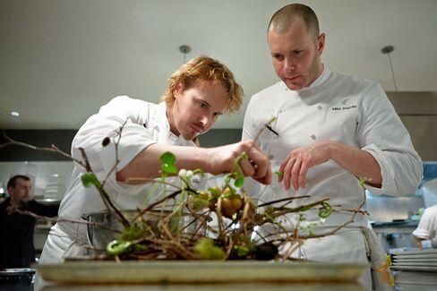 Restaurateur Grant Achatz, left, is the chef at Alinea.