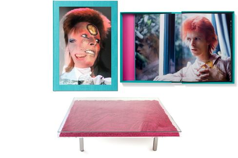 Pictured: An early '70s shot of David Bowie by photographer Mick Rock (top); Yves Klein's transparent pigment coffee table (bottom).