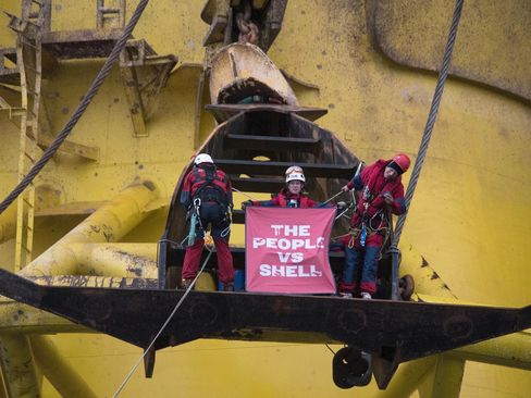 Greenpeace activists hold a banner that reads 'The People vs. Shell.'