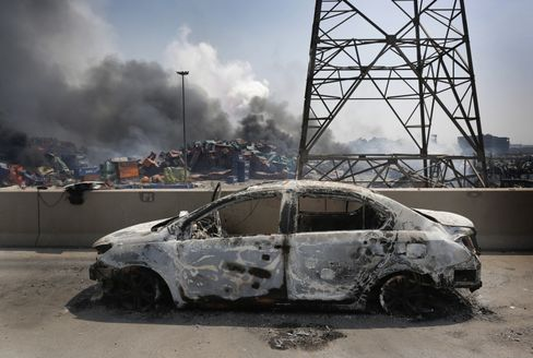 A burnt out car is seen at the site of a massive explosion at a warehouse in Tianjin, China on August 13, 2015.