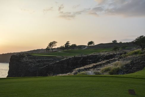 Sunset at the famed 12th Hole (par 3, 202-yard) of the Manele Golf Course, where the fairway is the ocean.