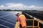A construction worker overlooks the under construction Renewable Energy Systems Ltd. solar park, on a former ArcelorMittal SA metals plant site in Laudun L'Ardoise, France, on Wednesday, June 9, 2021.