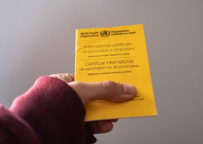 In this photo illustration a view of the vaccination card
