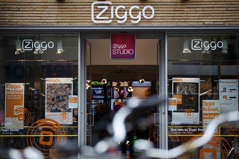 A Logo Sits Above the Entrance to a Ziggo NV Store in Utrecht