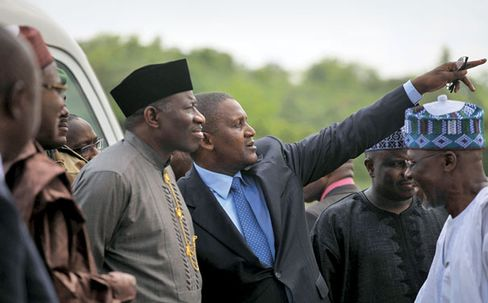 President Jonathan looks on last June as Dangote describes his plans to expand cement production in Obajana