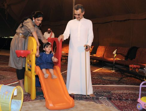 Prince Alwaleed bin Talal with his grandchild