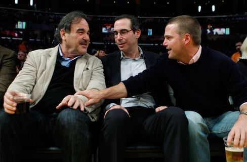 Film director Oliver Stone (left to right), Steven Mnuchin, and actor Chris O'Donnell at a Lakers game in Los Angeles on March 22, 2011.