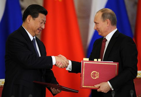 Xi's First State Trip Yields 'Breakthrough' Oil Deals With Putin