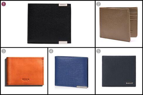 (1) Phileas Square wallet, Balenciaga, $305, balenciaga.com; (2) Leather bi-fold wallet, Lotuff Leather, $195, lotuffleather.com; (3) Slim bi-fold wallet, Shinola, $195, shinola.com; (4) Leather wallet, Tod's, $285, tods.com; (5) Leather wallet in new blue, Bally, $350, bally.com