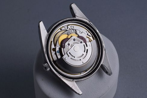 You have to remove both a screw-down caseback and an anti-magnetic cover to get to the automatic movement.