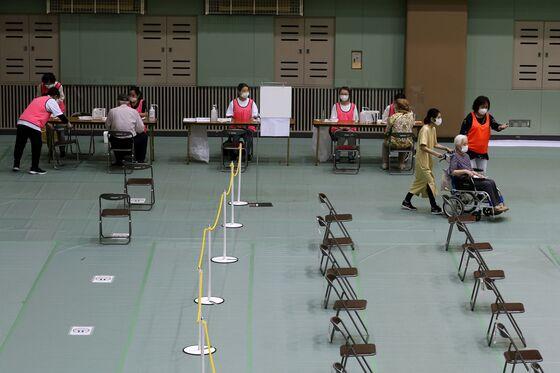 Slowest Vaccine Drive Makes Japan G-7's Worst Economic Performer