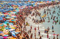Summer Holiday Season Begins And Tourists Flock To The Beaches In Spain