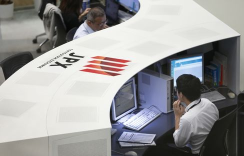 Tokyo Stock Exchange and Stock Boards As Japan Shares Dip With Banks As Volatility Returns to Markets