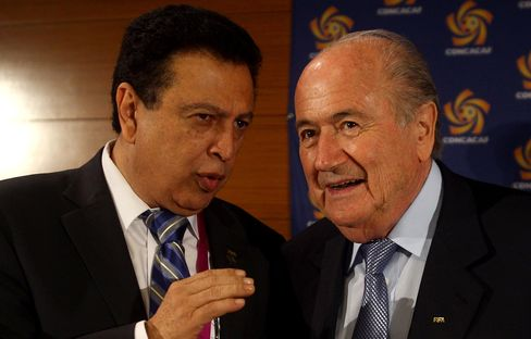 Alfredo Hawit speaks with Sepp Blatter prior the CONCACAF congress in Budapest, on May 23, 2012.