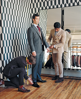 De Gruiter and Barret Wertz (left) measure Bennett's cuffs. Suitsupply suggests leaving a bit of shirt sleeve visible