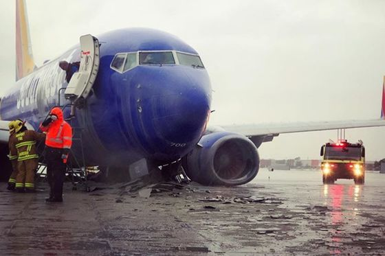 Southwest Jet Bellies to a Stop After Skid Off Rainy Runway