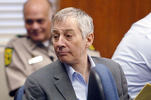 Defendant Robert Durst, center, sits with his attorney at the Galveston County Courthouse in Galveston, Texas, in this Nov. 10, 2003 file photo.