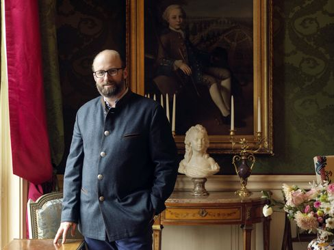 Prince Robert of Luxembourg poses in the Grand Salon at Restaurant Le Clarence in Paris.