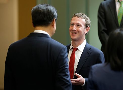 Chinese President Xi Jinping, left, talks with Facebook Chief Executive Mark Zuckerberg, right, during a gathering of CEOs and other executives at Microsoft's main campus September 23, 2015 in Redmond, Washington.