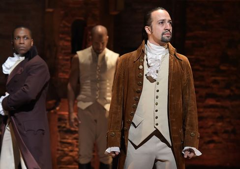 """Leslie Odom, Jr., left, and Lin-Manuel Miranda perform in """"Hamilton."""""""