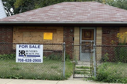 A Realty Sign Sits Outside a Home in Chicago