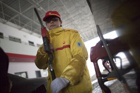 Stocks, Commodities Drop as China Growth Slows