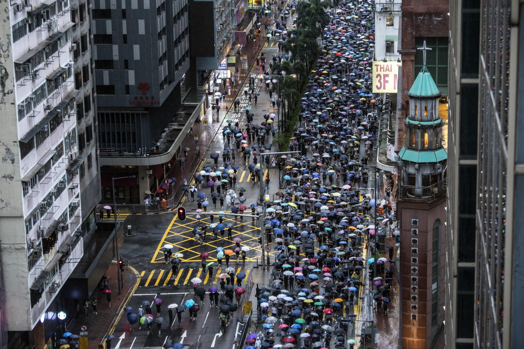 香港の著名民主派を「四人組」と個人攻撃-対応に苦慮する中国 - Bloomberg
