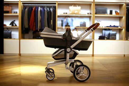 An Aston Martin baby stroller.